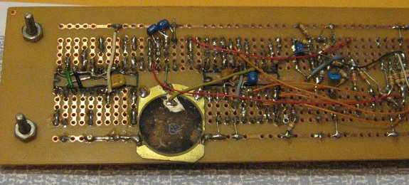 piezoelectric beeper on the back of a breadboard